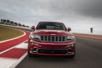 Picture of a driving 2016 Jeep Grand Cherokee SRT 4WD in Redline 2 Coat Pearl from a frontal perspective