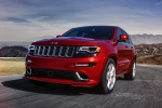 Picture of a driving 2016 Jeep Grand Cherokee SRT 4WD in Redline 2 Coat Pearl from a front left perspective