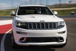 Picture of a driving 2016 Jeep Grand Cherokee SRT 4WD in Bright White Clear Coat from a frontal perspective