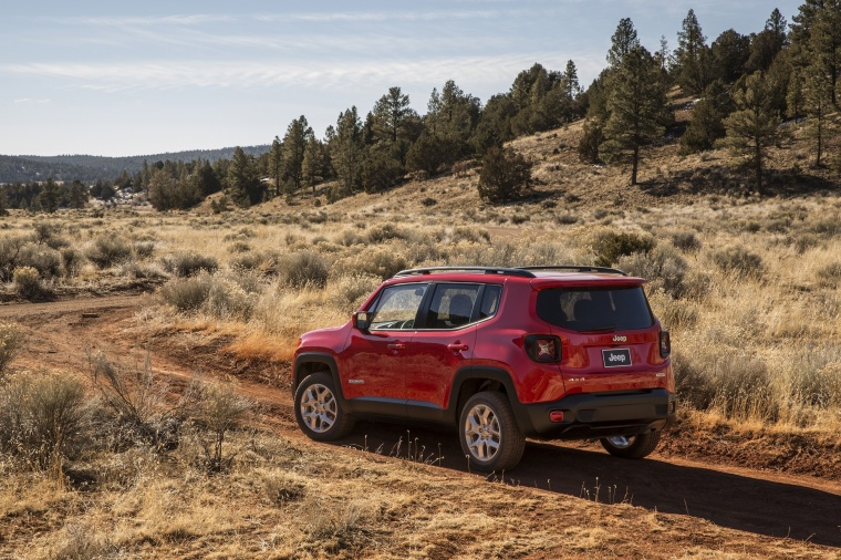 2017 Jeep Renegade Latitude 4WD in Colorado Red from a rear left three-quarter view