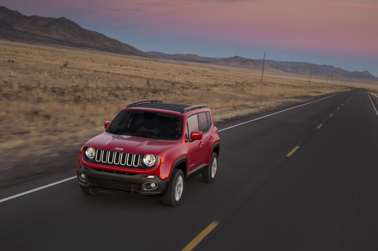 Driving 2017 Jeep Renegade Latitude 4WD in Colorado Red from a front left three-quarter view