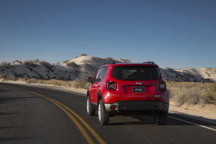 Driving 2017 Jeep Renegade Latitude 4WD in Colorado Red from a rear view