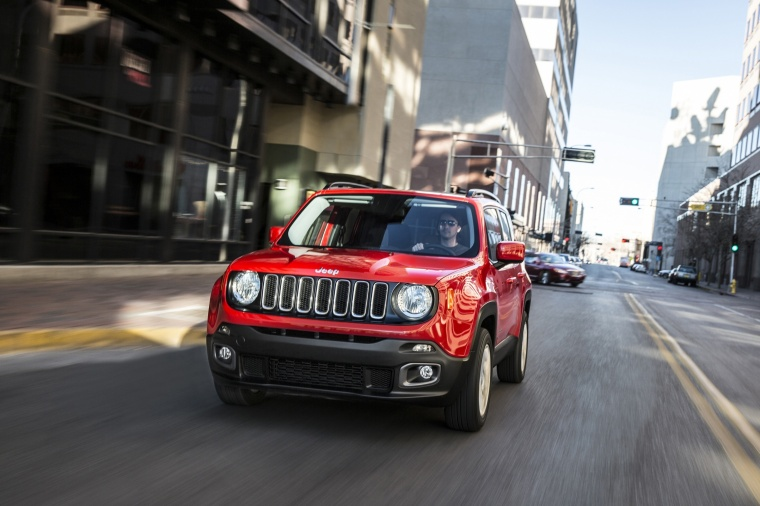 Driving 2017 Jeep Renegade Latitude 4WD in Colorado Red from a frontal view