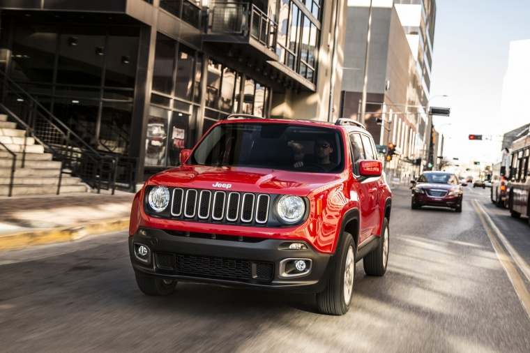Driving 2017 Jeep Renegade Latitude 4WD in Colorado Red from a front left view