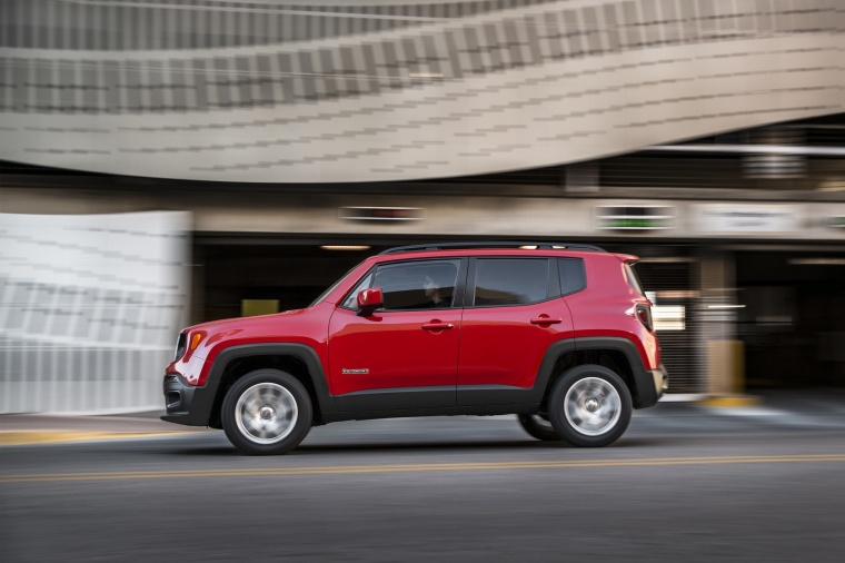 Driving 2017 Jeep Renegade Latitude 4WD in Colorado Red from a side view