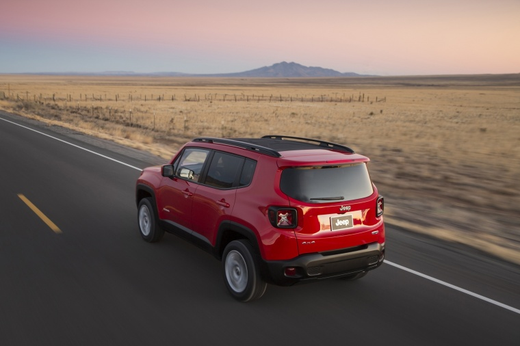 Driving 2018 Jeep Renegade Latitude 4WD in Colorado Red from a rear left three-quarter view