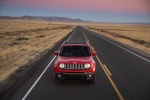 Picture of a driving 2018 Jeep Renegade Latitude 4WD in Colorado Red from a frontal perspective
