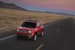Picture of a driving 2018 Jeep Renegade Latitude 4WD in Colorado Red from a front left three-quarter perspective
