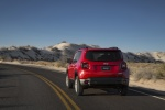 Picture of a driving 2018 Jeep Renegade Latitude 4WD in Colorado Red from a rear perspective