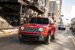 Picture of a driving 2018 Jeep Renegade Latitude 4WD in Colorado Red from a front left perspective