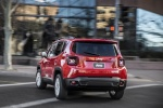 Picture of a driving 2018 Jeep Renegade Latitude 4WD in Colorado Red from a rear left perspective