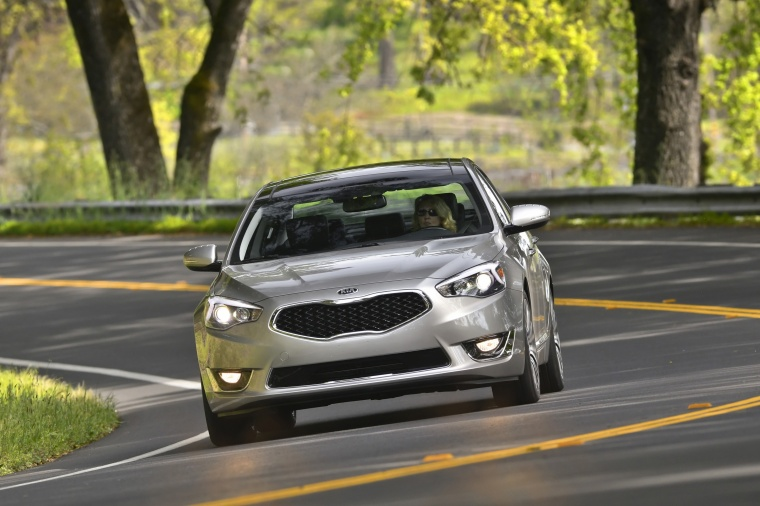 Driving 2016 Kia Cadenza in Silky Silver Metallic from a frontal view