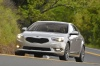 Driving 2016 Kia Cadenza in Silky Silver Metallic from a front left view