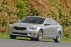 Driving 2016 Kia Cadenza in Silky Silver Metallic from a front left three-quarter view