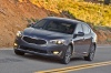 Driving 2016 Kia Cadenza from a front left three-quarter view