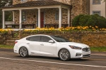 2017 Kia Cadenza Limited in Snow White Pearl - Driving Front Right Three-quarter View