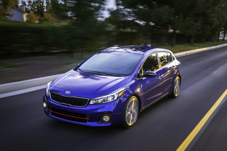 Driving 2018 Kia Forte5 Hatchback in Deep Sea Blue from a front left view