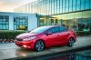2018 Kia Forte Sedan in Currant Red from a front left three-quarter view