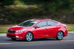 2018 Kia Forte Sedan in Currant Red - Driving Left Side View