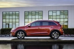 Picture of a 2018 Kia Niro Hybrid in Crimson Red from a side perspective