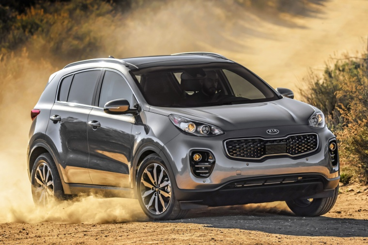 Picture of a driving 2017 Kia Sportage EX in Mineral Silver from a front right three-quarter perspective