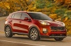 Driving 2018 Kia Sportage SX Turbo in Hyper Red from a front right three-quarter view