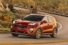 Driving 2018 Kia Sportage SX Turbo in Hyper Red from a front left three-quarter view