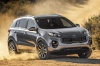 Driving 2018 Kia Sportage EX in Mineral Silver from a front right three-quarter view