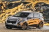 Driving 2018 Kia Sportage EX in Mineral Silver from a front left three-quarter view
