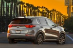 Picture of a 2019 Kia Sportage EX in Mineral Silver from a rear right perspective