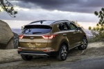 Picture of a 2019 Kia Sportage SX Turbo in Burnished Copper from a rear right perspective