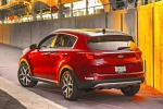Picture of a 2019 Kia Sportage SX Turbo in Hyper Red from a rear left perspective
