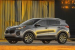 Picture of a 2019 Kia Sportage EX in Mineral Silver from a left side perspective