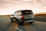 Picture of a driving 2020 Kia Telluride AWD in Dark Moss from a rear left perspective