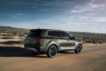 Picture of a driving 2020 Kia Telluride AWD in Dark Moss from a rear right three-quarter perspective