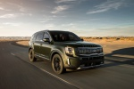 Picture of a driving 2020 Kia Telluride AWD in Dark Moss from a front right perspective
