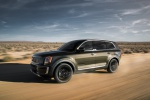Picture of a driving 2020 Kia Telluride AWD in Dark Moss from a front left three-quarter perspective