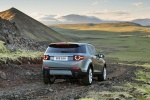 Picture of a driving 2018 Land Rover Discovery Sport HSE Luxury in Scotia Gray Metallic from a rear right perspective