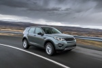 Picture of a driving 2018 Land Rover Discovery Sport HSE Luxury in Scotia Gray Metallic from a front right three-quarter perspective
