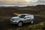 Picture of a driving 2018 Land Rover Discovery Sport HSE Luxury in Scotia Gray Metallic from a front left three-quarter perspective