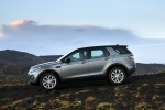 Picture of a driving 2018 Land Rover Discovery Sport HSE Luxury in Scotia Gray Metallic from a left side perspective