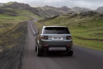 Picture of a driving 2018 Land Rover Discovery Sport HSE Luxury in Scotia Gray Metallic from a rear perspective