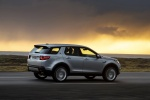 Picture of a driving 2018 Land Rover Discovery Sport HSE Luxury in Indus Silver Metallic from a rear right three-quarter perspective