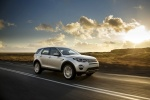 Picture of a driving 2018 Land Rover Discovery Sport HSE Luxury in Indus Silver Metallic from a front right three-quarter perspective