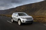 Picture of a driving 2018 Land Rover Discovery Sport HSE Luxury in Indus Silver Metallic from a front right perspective