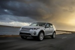 Picture of a driving 2018 Land Rover Discovery Sport HSE Luxury in Indus Silver Metallic from a front left three-quarter perspective