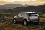 Picture of a driving 2018 Land Rover Discovery Sport HSE Luxury from a rear left three-quarter perspective