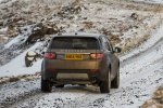 Picture of a driving 2018 Land Rover Discovery Sport HSE Luxury from a rear right perspective
