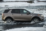 Picture of a driving 2018 Land Rover Discovery Sport HSE Luxury from a right side perspective