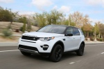 Picture of a driving 2018 Land Rover Discovery Sport HSE Luxury in Fuji White from a front left three-quarter perspective